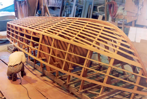 Custom cold-molded wooden boat building The 20' Coho