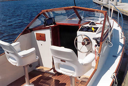 She Has The Stock White Bucket Chairs Teak Sole And Optional Consoles Aft Of Cabin Bulkhead Owner Went With 12 Coats