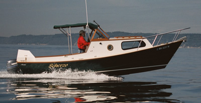 This custom wood boat, a 23' dory, is a fine small cruising boat