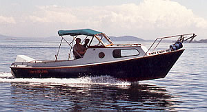 The 23' Dory, a fine custom wood dory for island camping and cruising
