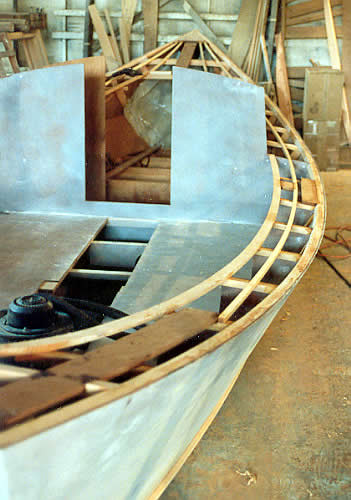 Custom wooden boat building the 27' St. Pierre Dory deck