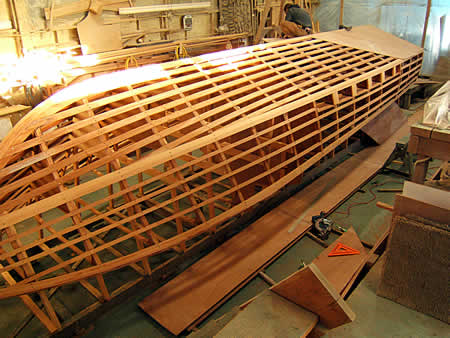 Custom cold-molded wooden boat building The Nexus 29
